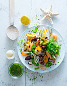 Seafood salad with olives and a herb dressing