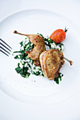 Roasted quail on a bed of spinach risotto