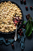 Vegan coconut crumble with sweet cherries and apples