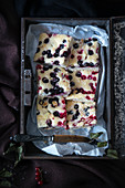 Vegan redcurrant cake in an old tin