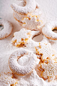 Vanilla crescent biscuits and shortbread almond stars in icing sugar
