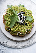 Matcha waffle cake with vanilla cream and fresh blackcurrants