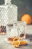 Two glasses with Borbon and a crystal decanter