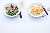 Broccoli and radish salad with croutons, and fennel salad with oranges and cheese