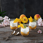 Yoghurt mousse with peaches in glasses