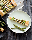 Asparagus tart with ricotta, one slice on a plate