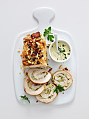 Turkey roulade with an almond and feta cheese filling served with a yoghurt and garlic sauce