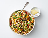 Pasta salad with grilled vegetables, pecorino and pistachios