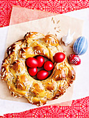 Greek Easter bread with red hard boiled eggs