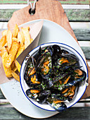 Mussels in a beer broth with onions, garlic and parsley