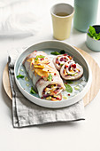 Sea bass roulade with red onions, peaches and prunes