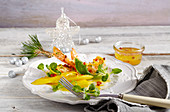 Fried prawns with mango salad and orange dressing