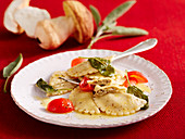 Porcini mushroom ravioli with sage butter and cherry tomatoes