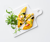 Frittata with tomatoes, olives and yoghurt and feta cream