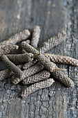 Long pepper on a wooden background