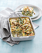 Lasagna with green and yellow beans, taleggio and hazelnuts