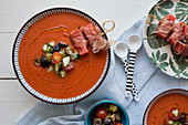 Watermelon gazpacho with serrano ham skewers, olives, tomatoes and cucumbers