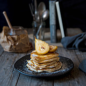 Pancakes with caramelised pears and honey