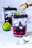 Refreshing summer cocktail with blackberries and rum