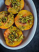 Oven-baked peaches with pistachios