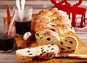 Raisin bread plait with icing (Christmas)