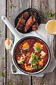 Turkish-style shakshuka with bacon bread sticks