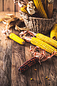 Autumn fruit with corn on wood