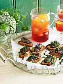 Pan-fried chicken livers and capers on crostini