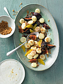 Roasted fig salad with candied ginger and oranges with sweet quark gnocchi