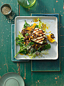 Spinach and lentil salad with dried mango, sesame seeds and grilled halloumi