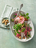 White radish salad with chioggia beets, croutons and lamb's lettuce with a maple syrup dressing