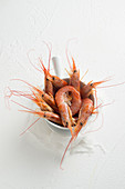 Fresh prawns in a white bowl