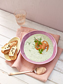 Cold cucumber soup with smoked salmon and crostini with pepper cheese