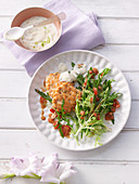 Salmon cakes with lime mayonnaise and salad