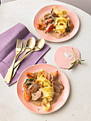 Pork fillets with sage, fresh apricots and tagliatelle