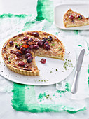 Onion cake with bacon and caramelised grapes