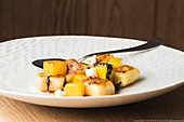 Roasted gnocchi with yellow beets