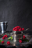 Fresh Wild Raspberried Piled in a Tarnished Silver Cup