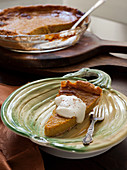 Slice of Sweet Potato Pie with Cream and Cinamon