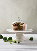 Brocolli Muffins in Parchment Paper Under a Glass Cloche