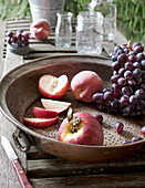 Metal Sieve with Grapes, Apple, and Sliced Peaches