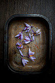 Saffron Flowers in a Metal Tray