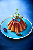 Flan with rosemary and animal figures