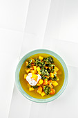Golden vegetable soup with kale chips