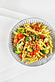 Broccoli pasta with baked tomatoes and anchovy crumbs