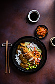Japanese katsu chicken with pickled cucumber, carrots in seasame oil and edame beans