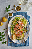 Orzo and hot smoked salmon salad with beans, letuce and lemon and olive oil dressing