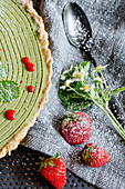 A vegan strawberry and matcha tart