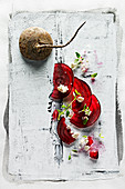 Food art: beetroot carpaccio with feta cheese and thyme