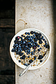 Porridge with berries, seeds, and bee pollen